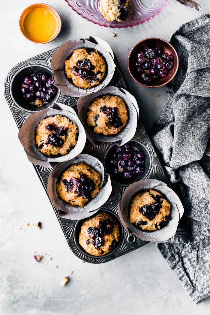 muffin tin filled with gluten free blueberry muffins