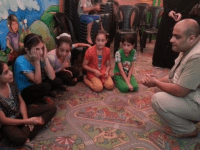 Mohammed El Halabi, World Vision's Area Development Programme Manager in Gaza, meets with children displaced by the violence during the brief ceasefire. Photo by Mohammad Awed