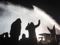 Water protectors stand tall and remain peaceful while law enforcement soaks them with water cannons in below-freezing temperatures. (Photo: Tara Houska/Twitter)