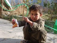 Ghulam Reza makes a toy for himself