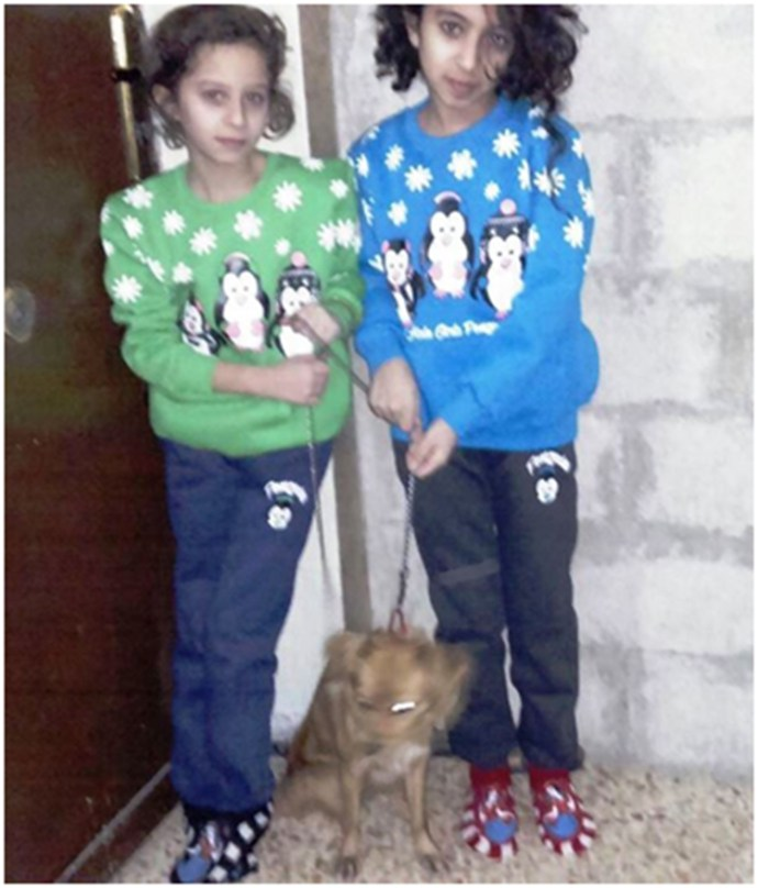 "Nagham and Lucy with their new puppy, ""Lucy"" on December 6, 2016.Ghina's leg is much better and she is also receiving physical therapy in Damascus.Photo: Franklin Lamb"