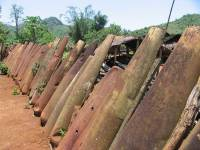 Laos Plain of Jars - village fence made of American bombs