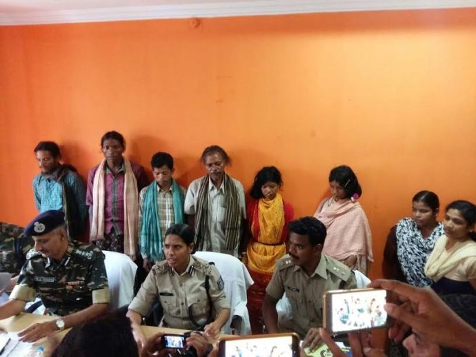 Kuni Sikaka (in yellow) with her relatives at the office of the superintendent of police at Rayagada, Odisha, on May 3.