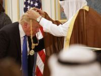 Saudi King Salman presents President Donald Trump with The Collar of Abdulaziz Al Saud Medal at the Royal Court Palace, Saturday, May 20, 2017, in Riyadh. (AP Photo/Evan Vucci)