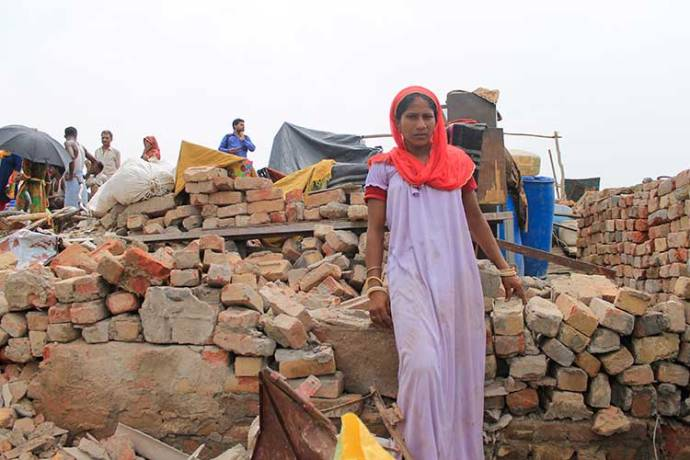 Ruchi Devi (Name Changed), the resident of Gulshan chowk slum shows her demolished house