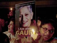 Indian protesters hold candles and placards during a candle light vigil to protest the killing of Indian journalist Gauri Lankesh in Hyderabad, Friday, Sept. 8, 2017. Lankesh's killing has provoked outrage and anguish across the country, with thousands protesting what they see as an effort to silence critics of India's ruling Hindu nationalist party. (AP Photo/Mahesh Kumar A.)