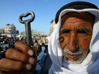 RAFAH REFUGEE CAMP, GAZA STRIP - MAY 15:  Palestinian refugee Mohamad Mahmoud Al-Arja, 80, from the Rafah refugee camp, holds up a key allegedly from his house in Beer AI-saba, now located in Israeli, during a rally May 15, 2007 the in Rafah refugee camp, southern Gaza strip. Palestinians are marking May 15, as Nakba Day or Catastrophe Day, as the 59th anniversary of the al-Nakba, the day the Israeli state was created in 1948.  (Photo by Getty Images)