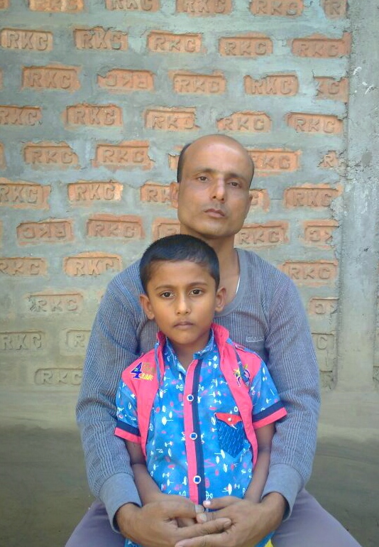 Kismat Ali with his son  at his residence in 1 No. Sonjauli village of Dimakuchi in Udalguri of Assam on Thursday.