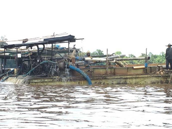 devilish mining machines on Borneo rivers
