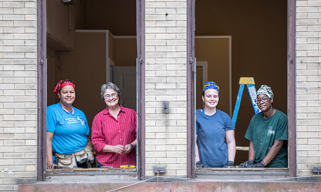 Production Manager Nannette Bowie, founder, Pam Howland, worker/owner Leishla Lugo, and worker/owner Shaniqua Dobbins (left to right) representing Old Window Workshop at a worksite in Springfield MA on October 6, 2017.