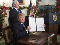Donald Trump signs an executive order declaring Jerusalem the capital of Israel at the White House on 6 December. Chris KleponisCNP