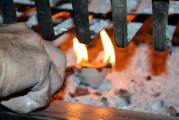 Lighting an egg carton fire starter