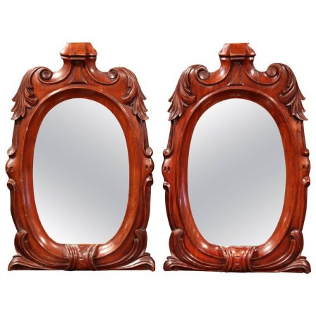 Pair of 19th Century Regency-Style Carved Mahogany Mirrors with Foliage