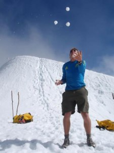 Juggling five snowballs near the summit