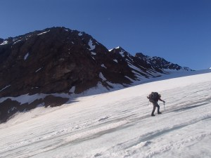 Len trudging up the glacier with Peak 46 in the background