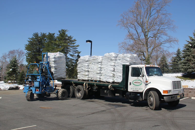 Flatbed truck loaded with bagged mulch