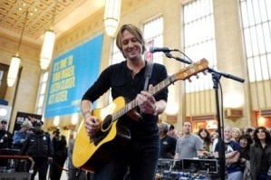 Keith Urban is performing in some very unlikely places – train stations and malls