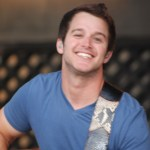 Easton Corbin on stage at Greene County Fair