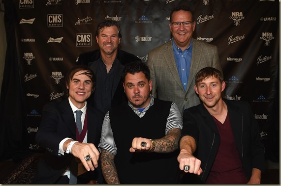 NASHVILLE, TN - NOVEMBER 01:  (Back Row, L-R): CMS Nashville Chairman and CEO Chris King and Jostens VP, Curt Bruns, (Front Row, L-R): CMS Nashville Songwriter of the Year honorees Ross Copperman, Josh Hoge, and Ashley Gorley attend the Folds of Honor/CMS Nashville Songwriter of the Year Party on November 1, 2016 in Nashville, Tennessee.  (Photo by Rick Diamond/Getty Images for CMS)