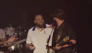 """Couple engaged during Lee and Lewis Brice performance of """"Alabama"""""""