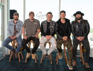 """Morgan Wallen toasts """"Up Down"""" with rooftop #1 Party"""