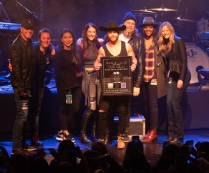 "Chris Lane scores first Platinum single with ""Take Back Home Girl"""
