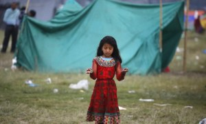 Nepalese girl in clearing, standing in the rain