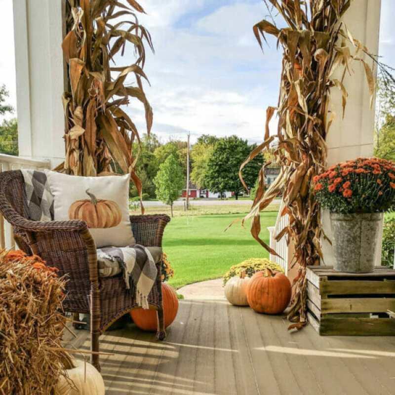 porch with cornstalks and pumpkins