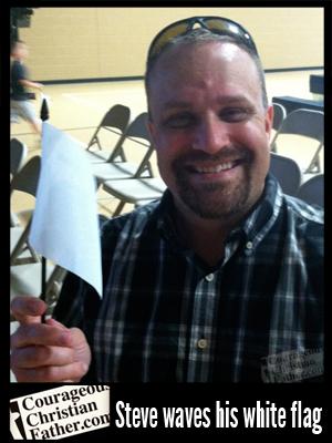 Steve waves his white flag at the 2013 Unity Festival.