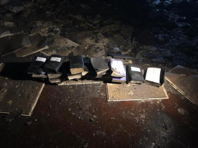 Fire does not touch any of the church's Bibles - This now just happened in Grandview, WV at Freedom Ministries Church. The firefighting crew was stunned to see these Bibles survived due to how hot this devastating fire was.