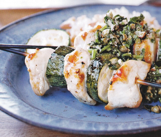 Skewered chicken goes great on the grill - Grilling chicken is an easy way to transform this versatile food into something even more delicious. Various cultures serve chicken in kebab form after grilling it over an open flame, and taste is a big reason this particular method of cooking chicken is so beloved. Recipe for Spiedini of Chicken and Zucchini with Almond Salsa Verde.