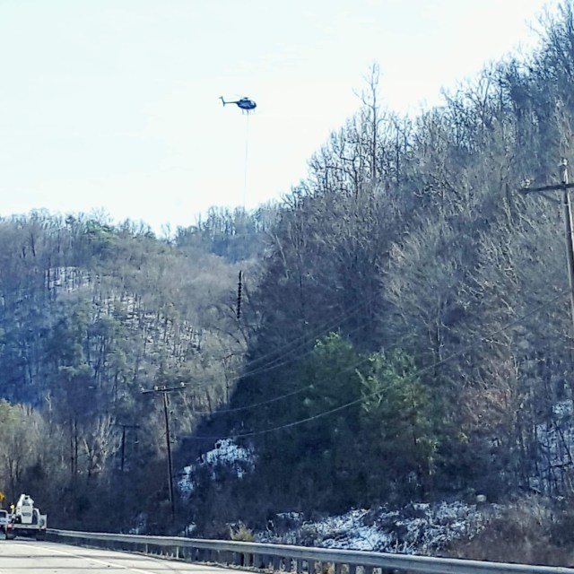 Outside my window I cannot believe … A helicopter cutting down trees along Highway 25E between Harrogate, TN and Jefferson City, TN.  Photo Credit: Heather Patterson