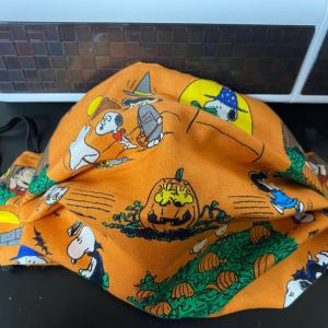 Great Pumpkin Face Mask - this face mask is based off the Great Pumpkin Charlie Brown with Charlie Brown, Snoopy, Woodstock, Linus, etc.