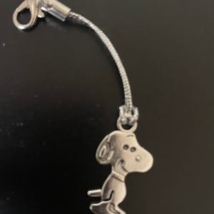 Metal Snoopy on a lanyard