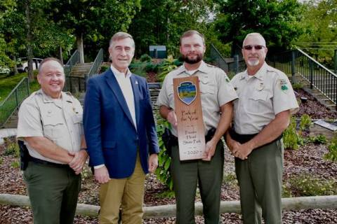 Frozen Head State Park Named State Park of the Year - The Tennessee State Parks Park of the Year Award is presented to Frozen Head State Park. From left are Mike Robertson, director of park operations; Jim Bryson, deputy commissioner of TDEC; Jacob Ingram, park manager; and Kim Moore, area manager.