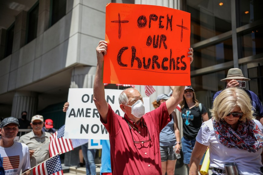 California to revise indoor church guidelines after Supreme Court ruling - Unlike Tennessee, where I live, we got to go back to indoor in-person worship a while ago, however, California, still had an in-person Worship Ban. However, that all will soon change. #California - Demonstrators holding signs demanding their church to reopen, protest during a rally to re-open California and against Stay-At-Home directives on May 1, 2020 in San Diego, California. - Rallies have been held at several state capitols across the country as protesters express their deep frustration with the stay-at-home orders that are meant to stem the spread of the novel coronavirus. (Photo by SANDY HUFFAKER/AFP via Getty Images)
