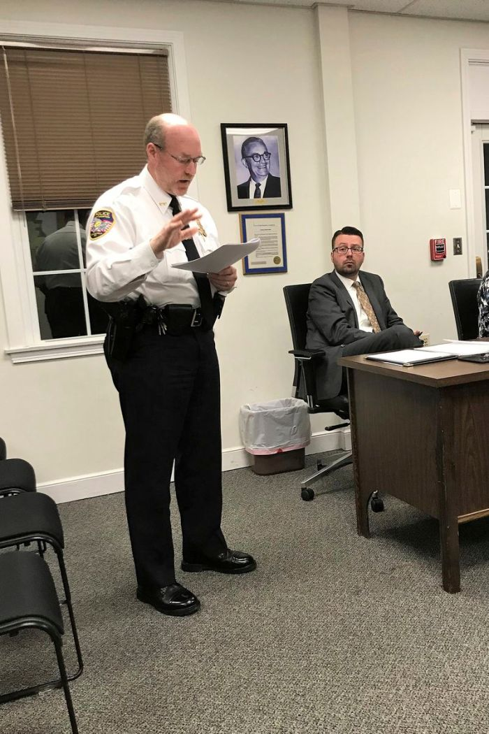 In this Nov. 14, 2018 photo, East Hampton Police Chief Dennis Woessner addresses the Town Council in East Hampton. Woessner has concluded that an officer's membership in a far-right group infamous for engaging in violent clashes at political rallies didn't violate any department policies. Woessner said that officer Kevin P. Wilcox is no longer associated with the Proud Boys group.