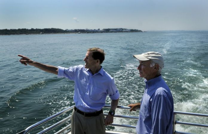 Members of Connecticut's congressional delegation, Sen. Richard Blumenthal, left, and Rep. Joe Courtney, take a tour around Plum Island in 2013. (Courant file photo)