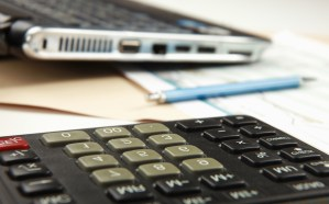 Calculator, pen, folder with documents, laptop CourseCoder technology expenses for online courses