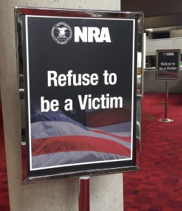 NRA placard reading Refuse to be a Victim