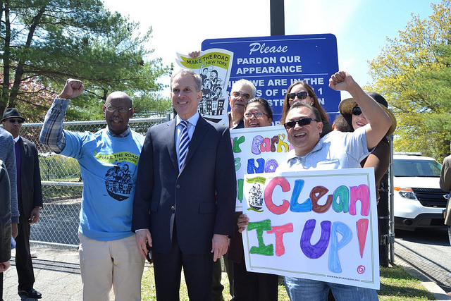 New Yorkers pose with state Attorney General Eric Schneiderman on May 4, 2017, at press conference on making polluters pay for toxic dumping at a Long Island park named for Roberto Clemente. (Flickr via Courthouse News)