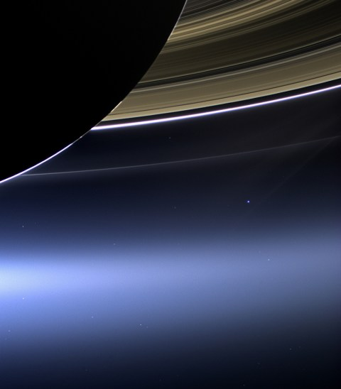 In this rare image taken on July 19, 2013, the wide-angle camera on NASA's Cassini spacecraft has captured Saturn's rings and our planet Earth and its moon in the same frame. It is only one footprint in a mosaic of 33 footprints covering the entire Saturn ring system (including Saturn itself). At each footprint, images were taken in different spectral filters for a total of 323 images: some were taken for scientific purposes and some to produce a natural color mosaic. This is the only wide-angle footprint that has the Earth-moon system in it. (NASA/JPL-Caltech/Space Science Institute)