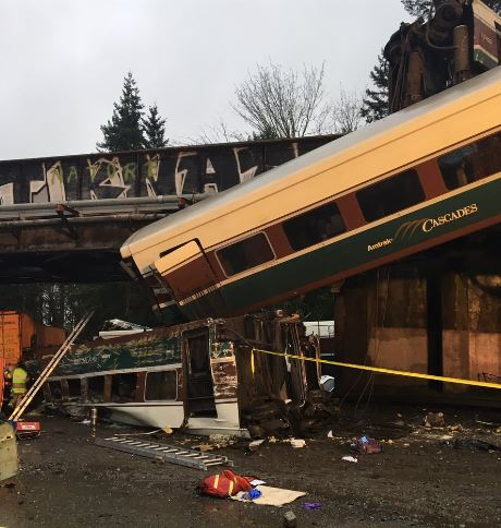 Three cars on Amtrak train with 311 passengers derail, none hurt