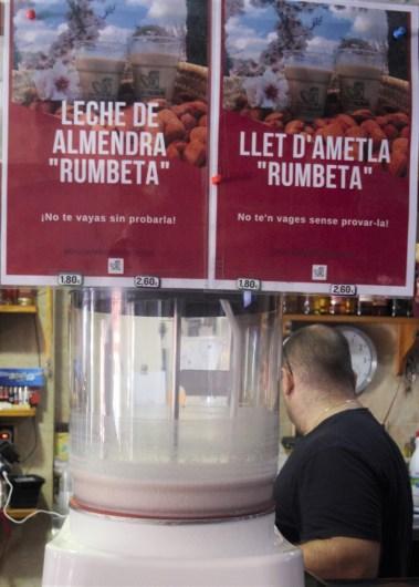 A bar sells almond milk in Alcalalí, a town in the province of Alicante, Spain, where a lethal bacterium from Central America is killing almond trees. The Xylella fastidiosa bacterium is considered one of the most dangerous threats to Europe's crops. (Photo by CAIN BURDEAU/Courthouse News Service)