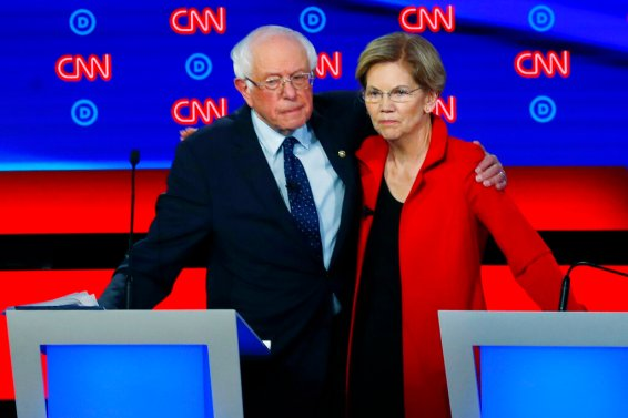 Sen. Bernie Sanders, I-Vt., and Sen. Elizabeth Warren, D-Mass., embrace on July 30, 2019, after the first of two Democratic presidential primary debates hosted by CNN in the Fox Theatre in Detroit. (AP Photo/Paul Sancya)