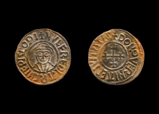 A coin that was part of a $4 million Viking hoard that metal detectorists George Powell and Layton Davies have been convicted of stealing. Two amateur British treasure-hunters were imprisoned Friday for stealing a hoard of 1,100-year-old Anglo-Saxon coins and jewelry valued at millions of dollars. Experts say the hoard, much of which is still missing, could shed new light on a period when Saxons were battling Vikings for control of England. (British Museum via AP)