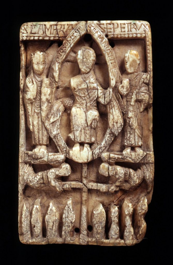 This example of an elaborately carved ecclesiastical walrus ivory plaque from the beginning of the medieval walrus ivory trade, believed to date from the 10th or 11th century, was found in North Elmham, Norfolk, UK, in the 19th century. Featuring the figure of Christ, together with St. Mary and St. Peter, the plaque is exhibited in the University of Cambridge's Museum of Archaeology and Anthropology.