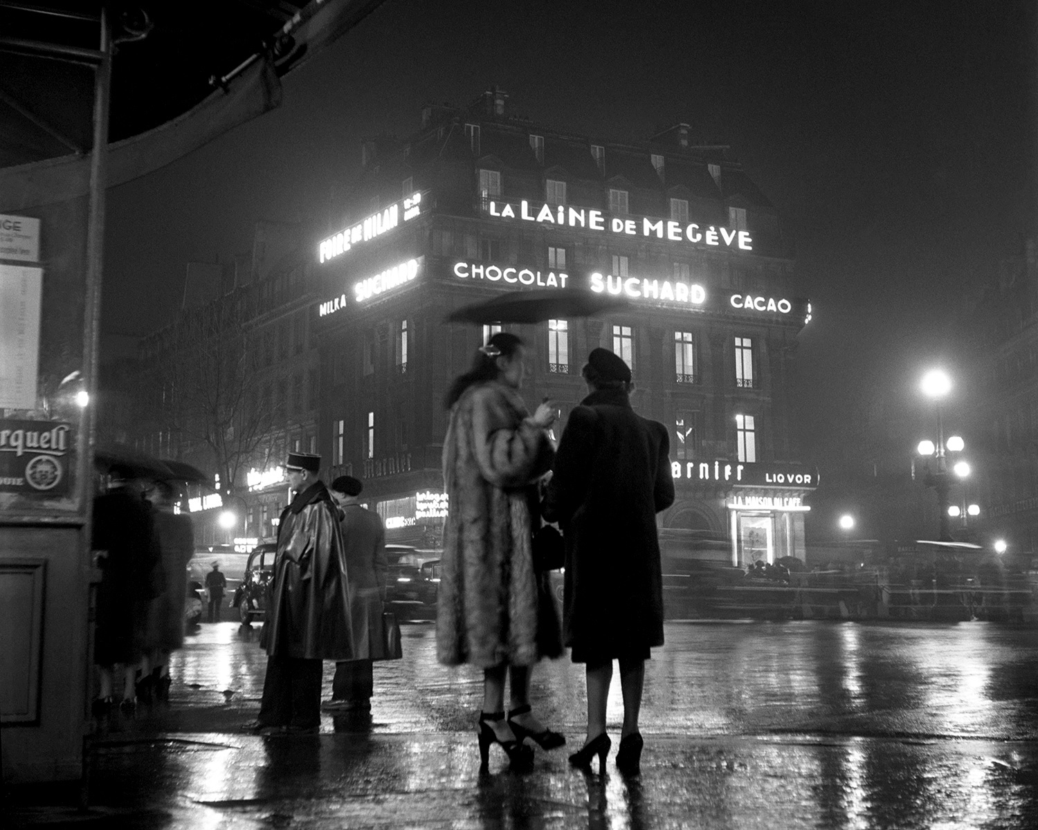 Paris street on a rainy night. From Walt Girdner's Paris collection.