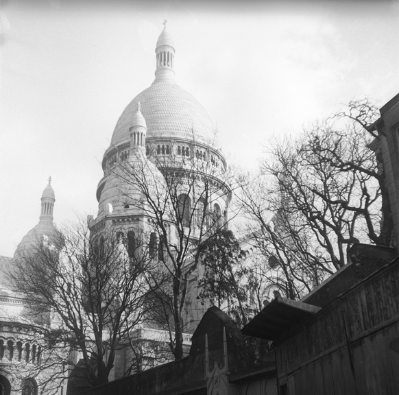 The Sacré-Cœur Basilica glitters like an alabaster jewel above Paris, perched on the summit of the butte Montmartre — the city's highest point. The basilica is Paris' second most visited monument behind the Eiffel Tower. From Walt Girdner's Paris collection.