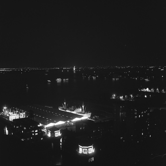 Night shot of New York harbor circa 1952.
